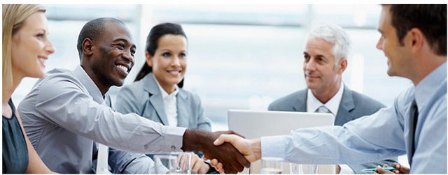 Photo of a Meeting with several professionals sitting around a conference table.